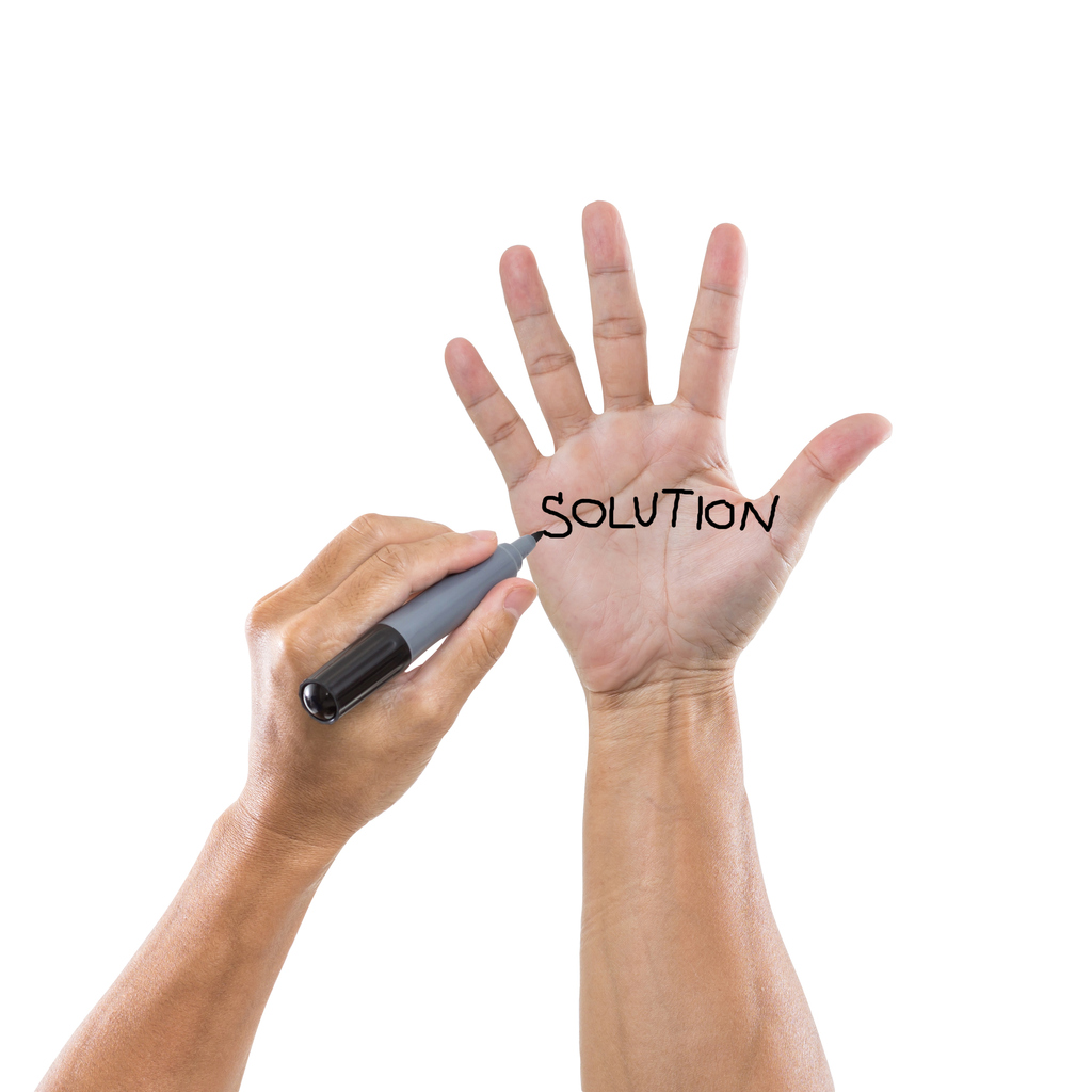write-solution-on-hand-isolated-white-background-476393895_1025x1025.jpeg